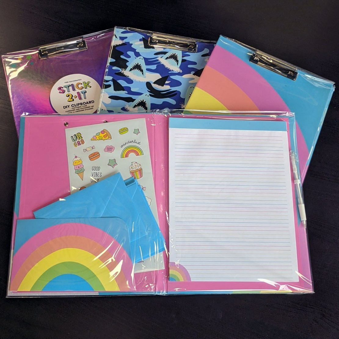 Clipboards with stickers and paper