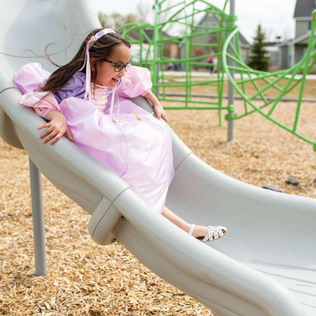Princesses like to play at the park.