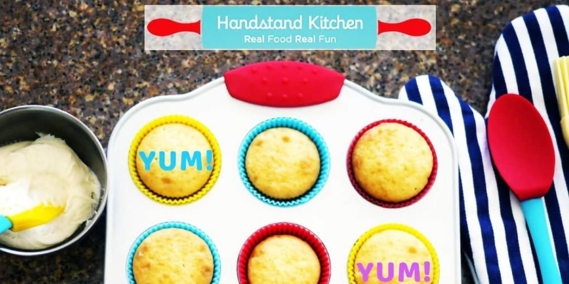 Handstand Kitchen Yum Logo